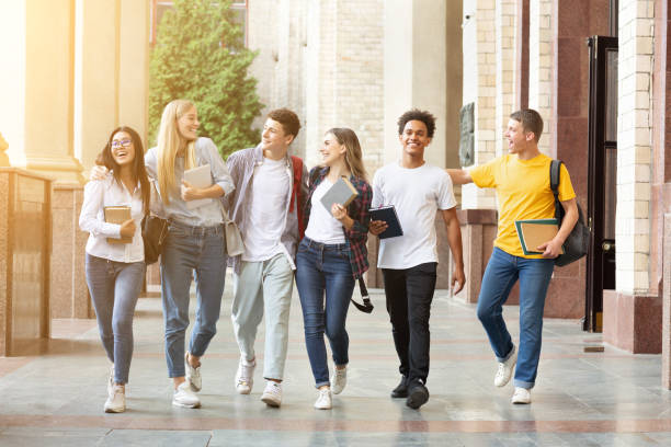 Group of college students walking and laughing